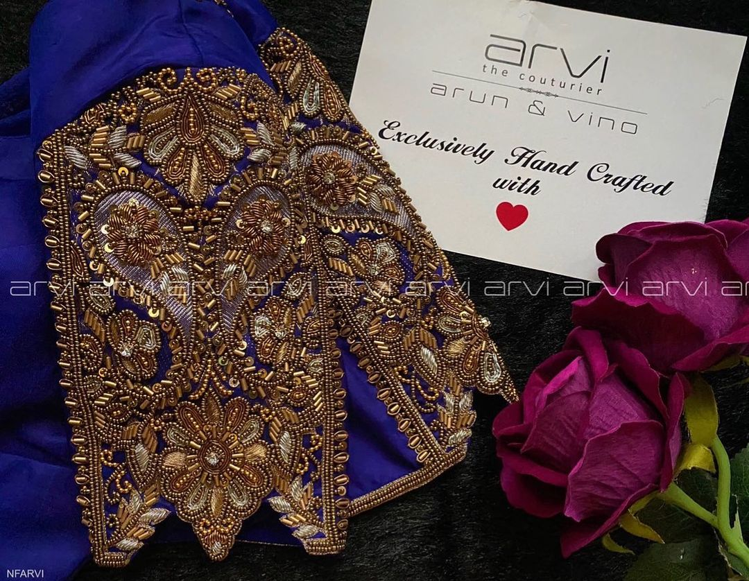 Lovely deep blue color designer blouse with floral bead aari work on sleeves. 2021-01-26
