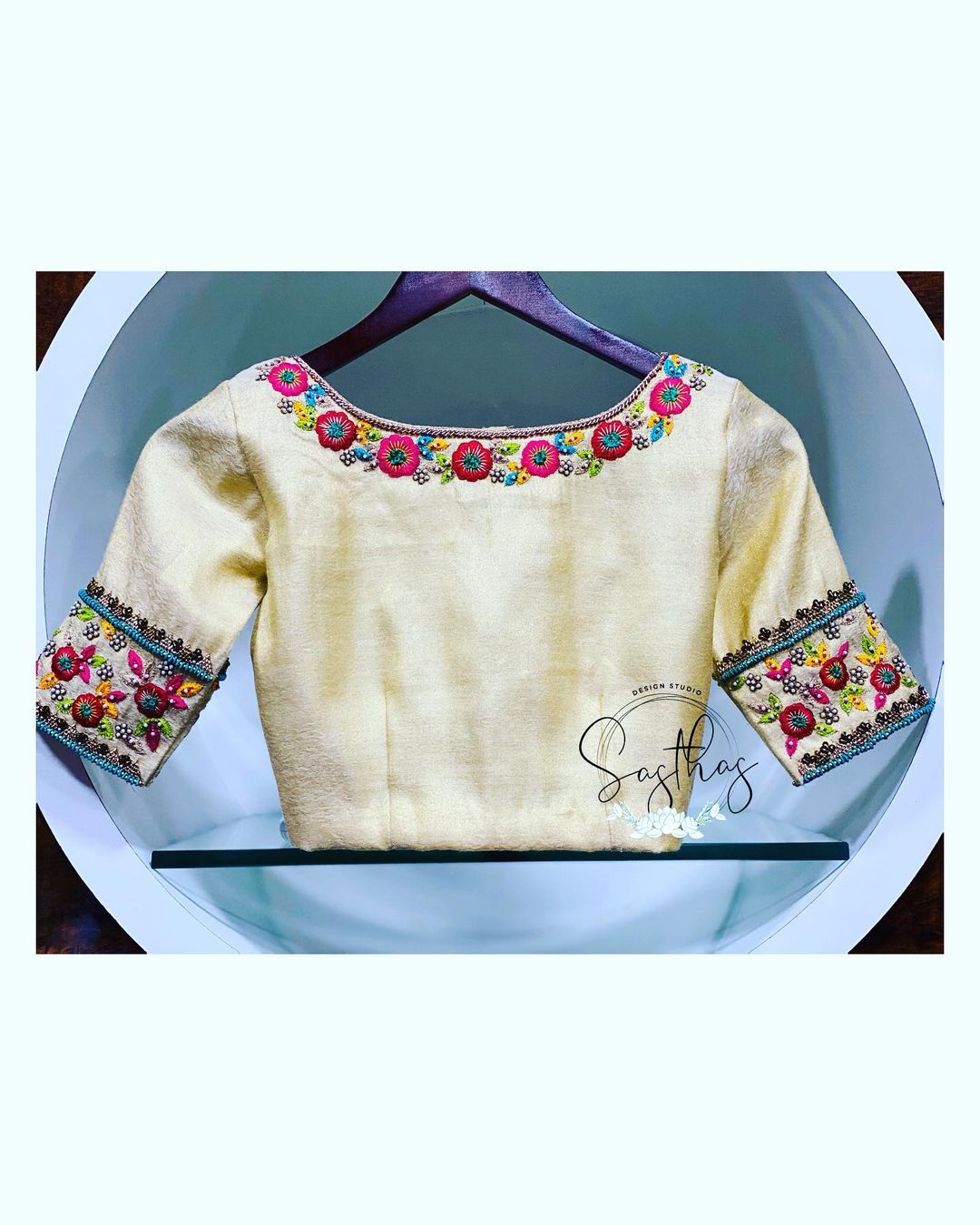 Gorgeous off white color designer blouse with multi color thread maggam work on neckline and sleeves. 2021-01-27