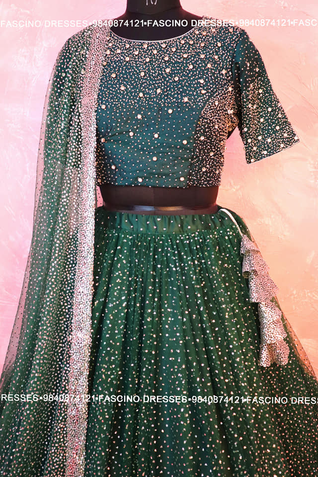 A gorgeous Bridal Lehenga from Fascino. Bottle green with silver shimmer skirt paired up with hand crafted blouse for a beautiful bride . Wats app or inbox to order 9840874121 Can customize in any color / size 2021-01-30