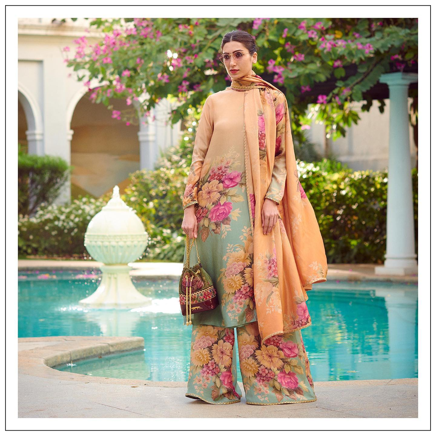 A hand painted and printed Indian pure silk kurta-pyjama. Bespoke print by the Sabyasachi Art Foundation. The look is accessorised with the Nani Bucket in Alhambra by Ssabyasachi accessories.  For all product related queries  please email  at customerservice@sabyasachi.com or contact retail stores directly. 2021-01-30