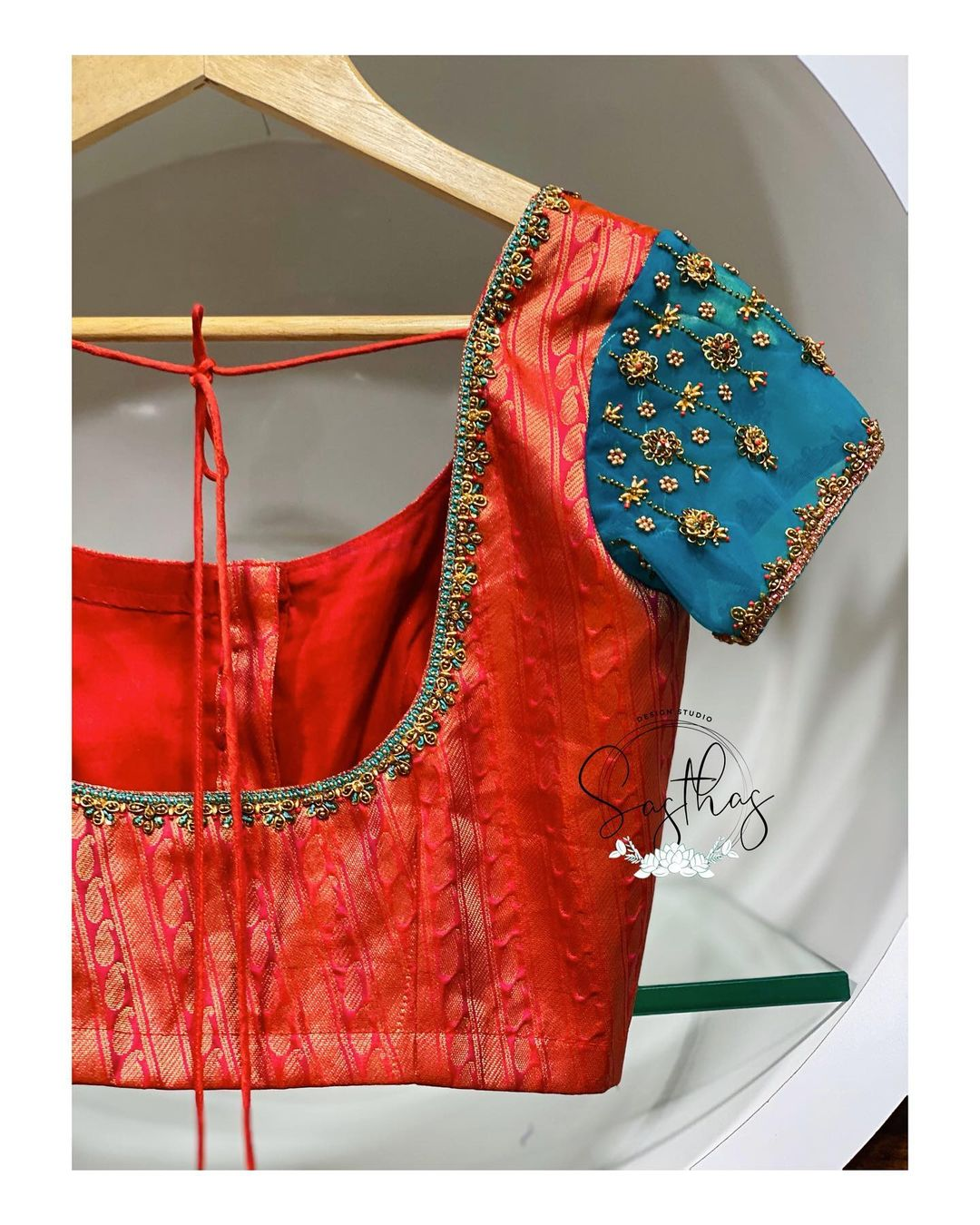 Stunning designer blouse with 3D floral hand embroidery bead aari work on short sleeves and neckline.  2021-01-30