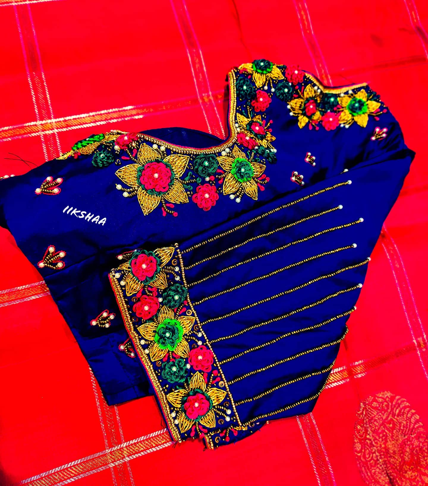 Gorgeous royal blue color designer blouse with floral design hand embroidery thread and bead  aari work. 2021-01-31