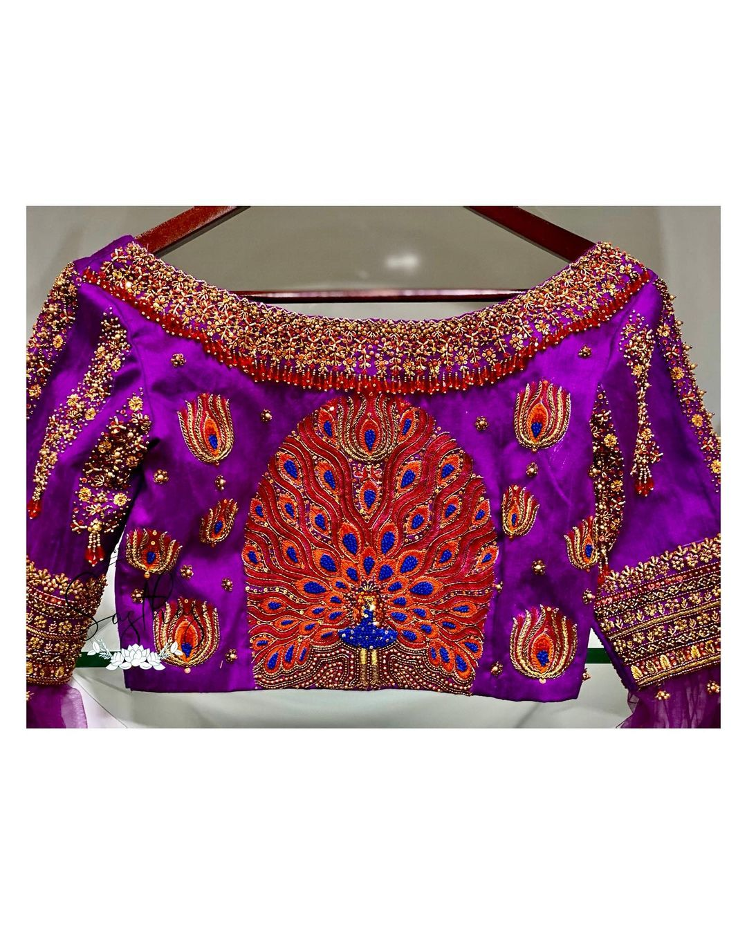 Stunning purple color designer blouse with dancing peacock design hand embroidery aari work blouse.  2021-01-31