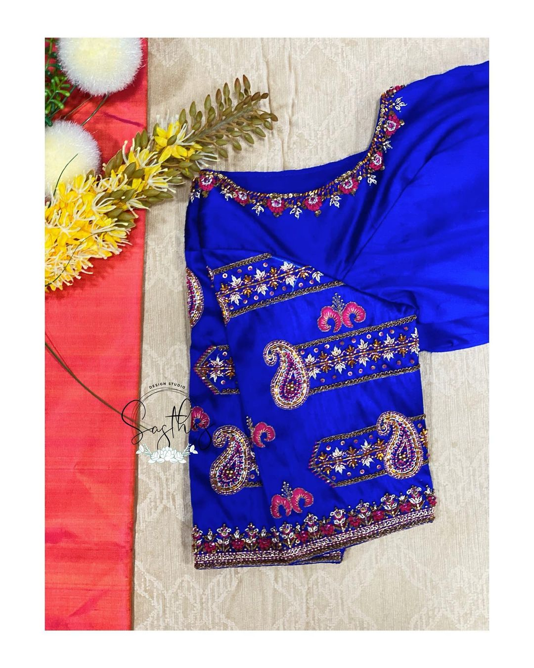 Stunning royal blue color designer blouse with simple aari work on neckline and sleeves. 2021-02-02
