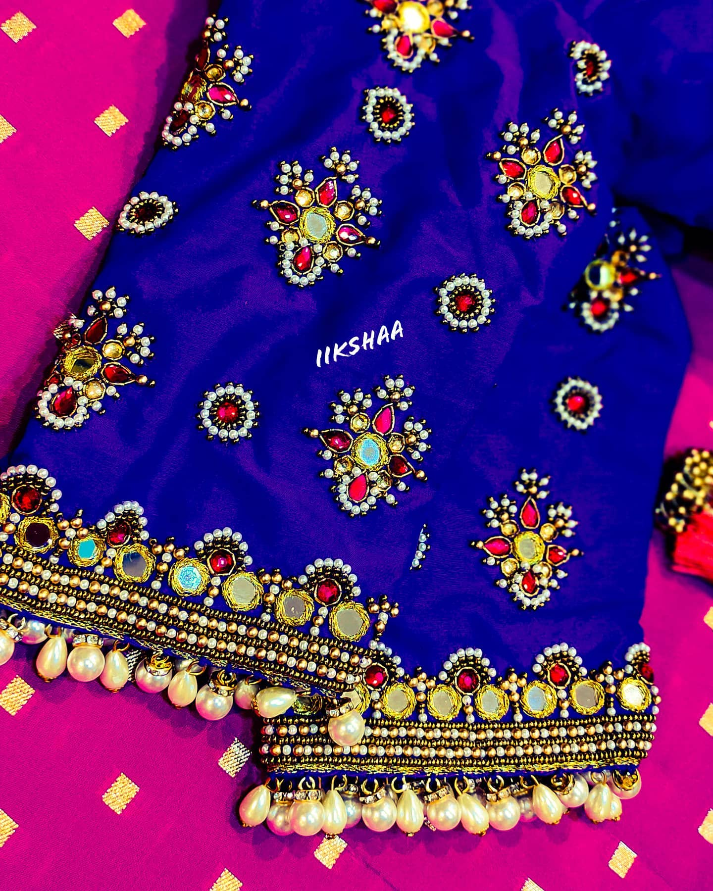 Stunning blue color bridal blouse with bead and mirror aari wrok. 2021-02-04