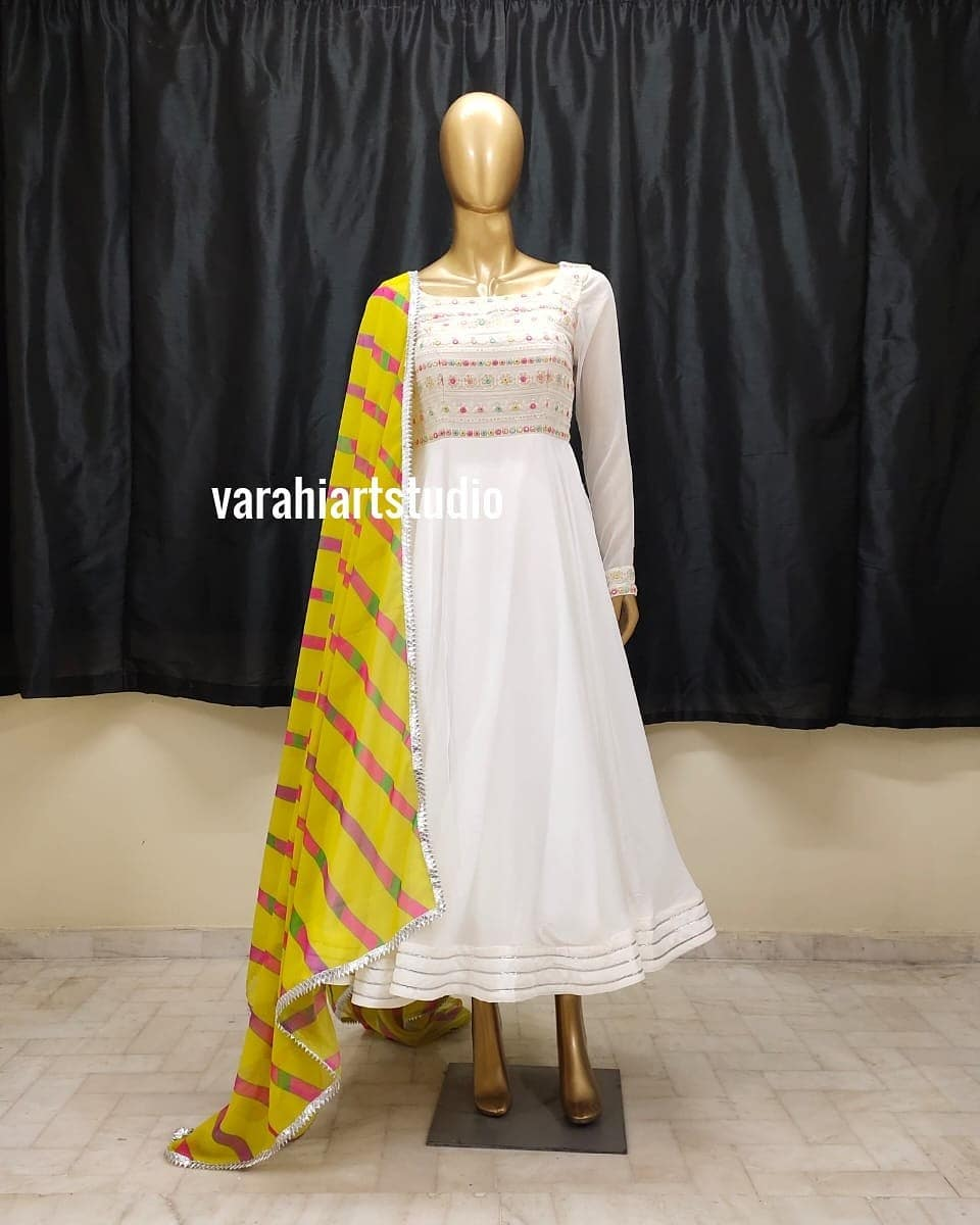 Stunning pearl white color ankle length dress with yellow and pink color leheriya dupatta. This Outfit is Available at Rs 5800 from Varahiartstudio .. They can customise the size as per your Measurements .. .. They have international shipping service too