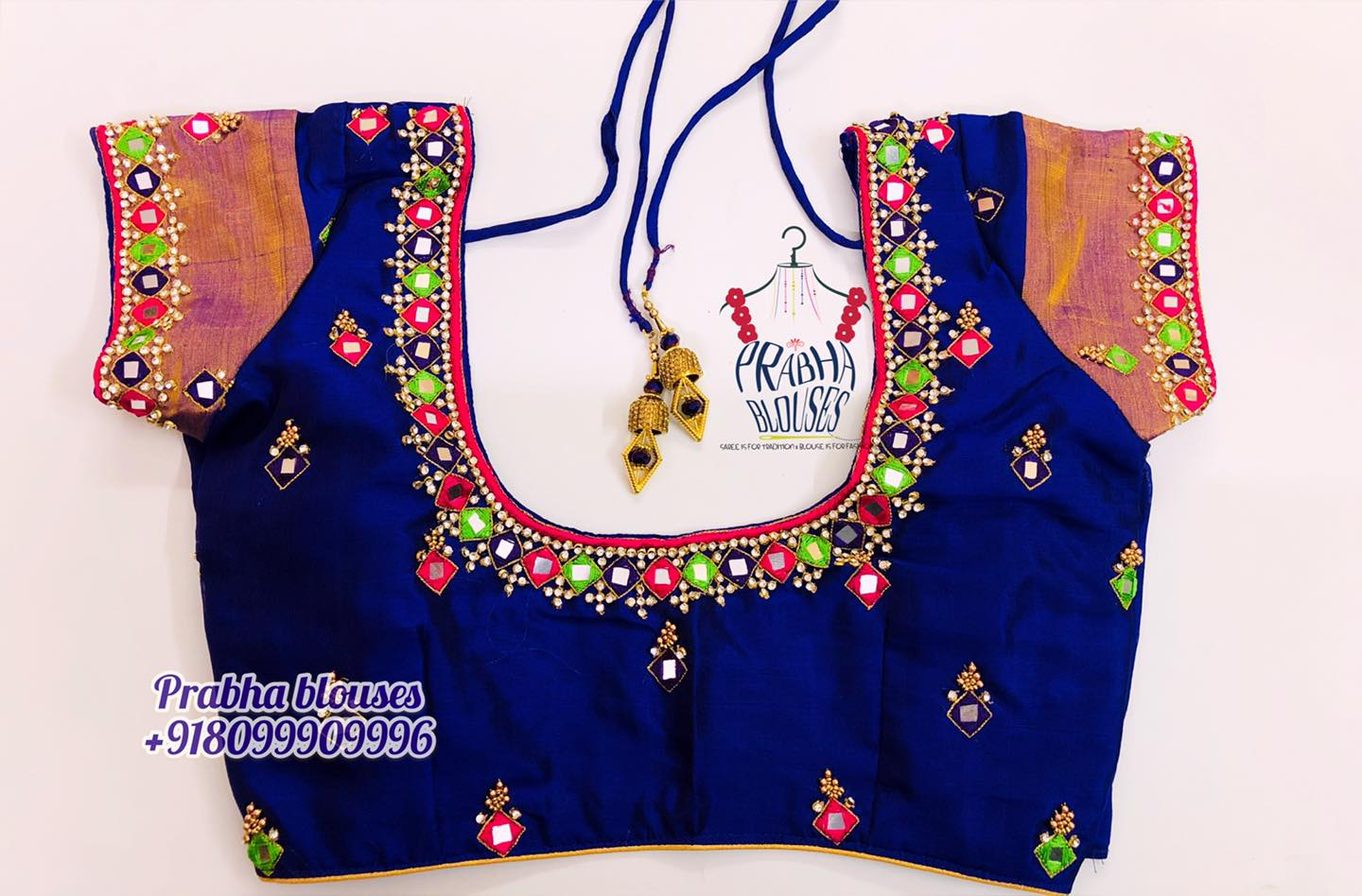 Stunning blue color designer blouse with hand embroidery mirror thread and kundan mmaggam work.  2021-02-05