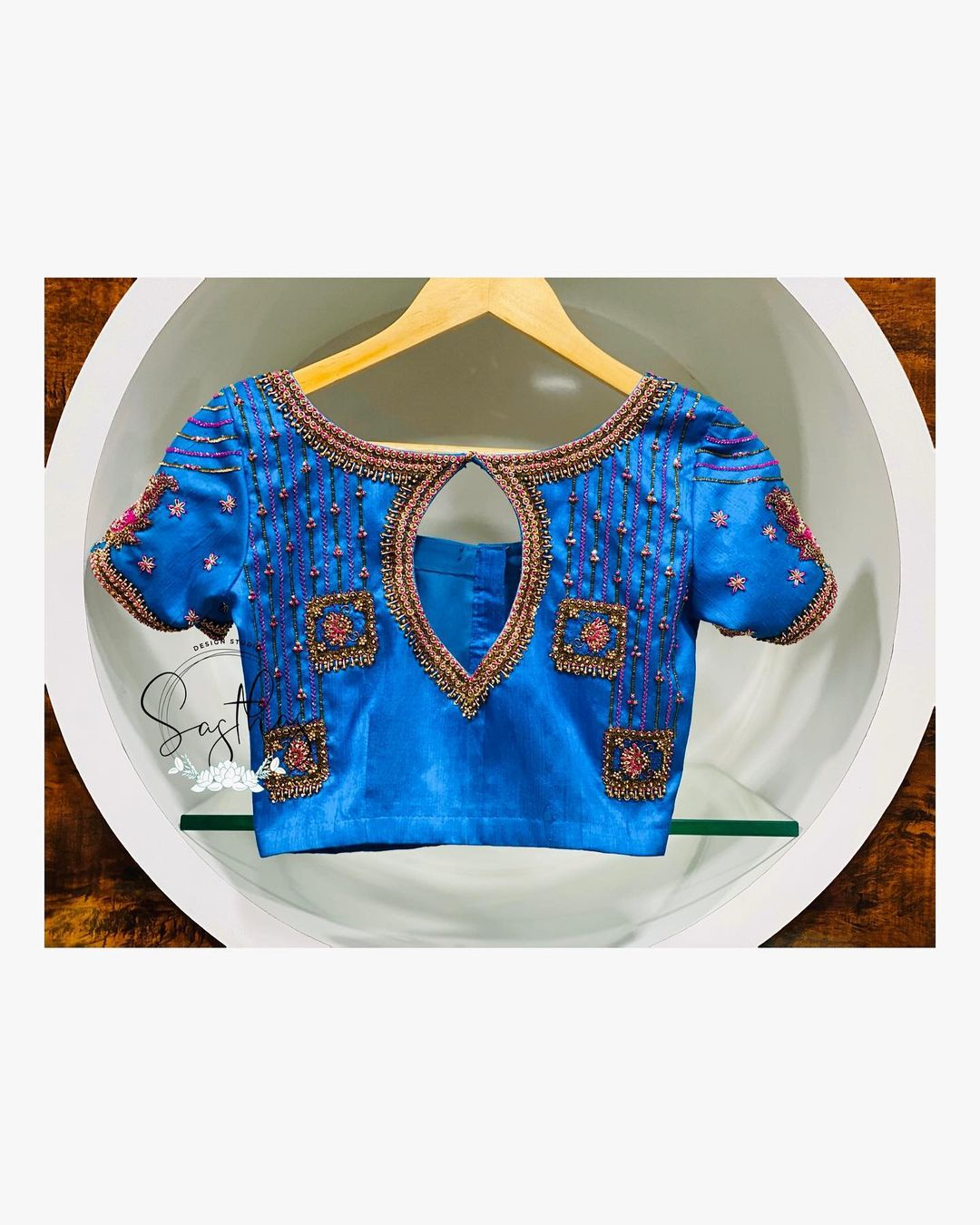 Stunning blue color key hole blouse with falling square design hand embroidery bead work.  2021-02-05