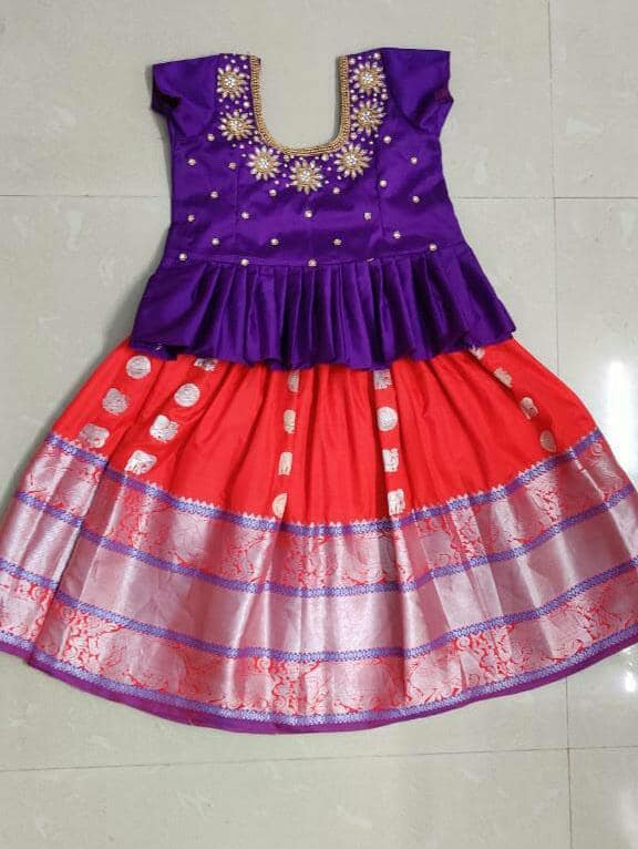 Traditional kids red color pattu lehenga and purple color parikini. Kids peplum top with hand embroidery work on neckiline.  2021-02-09