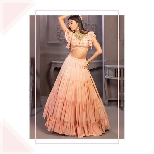 Embellished in pastel elegance. Lovely pastel skirt and crop top with ruffle sleeves.