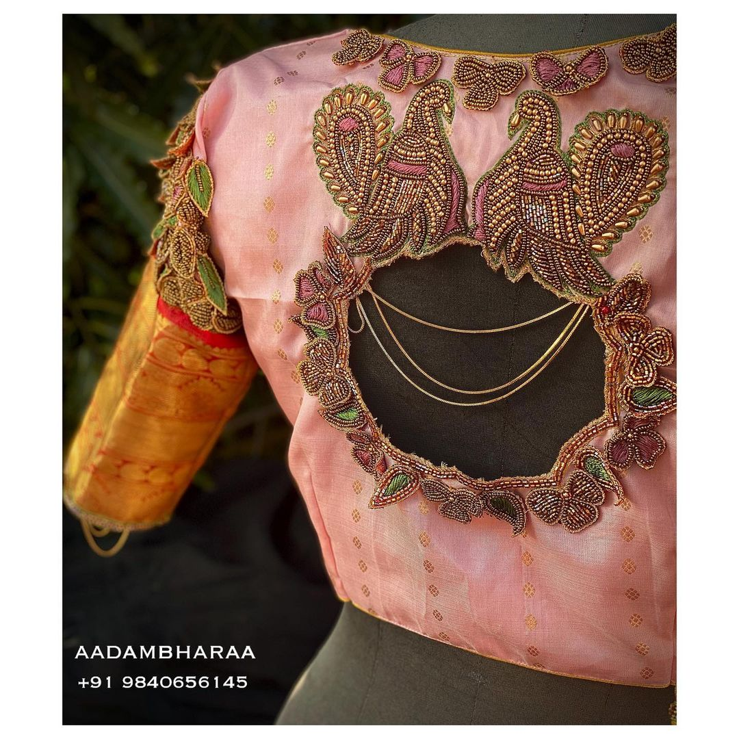 Here is a Pastel pink blouse by Aadambharaa that is sure to put you on spot light with its unique 3D hand embroidered motifs on the sleeve by Aadambharaaartisans! 2021-02-09