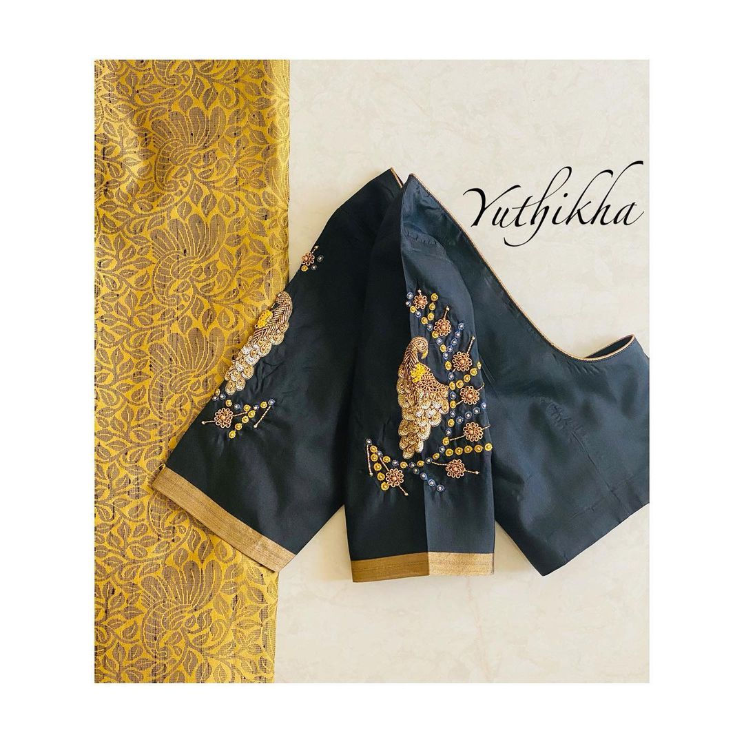 Love  with peacock embroidery !!! Simple and elegant embroidery blouse from the house of yuthikha designer studio !! For appointments contact 9894231384 . - Not for sale !! 2021-02-13