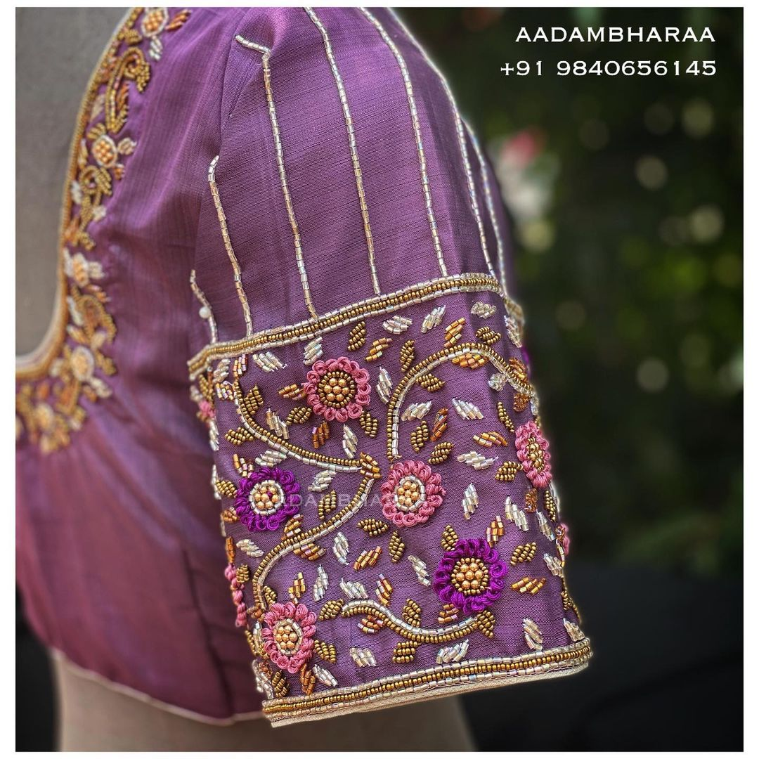 Exquisitely hand embroidered to perfection the mauve blouse is embellished with silver Glass bead work and rosette knot stitch embroidery technique created by Aadambharaa skilled artisans of Aadambharaa. 2021-02-13