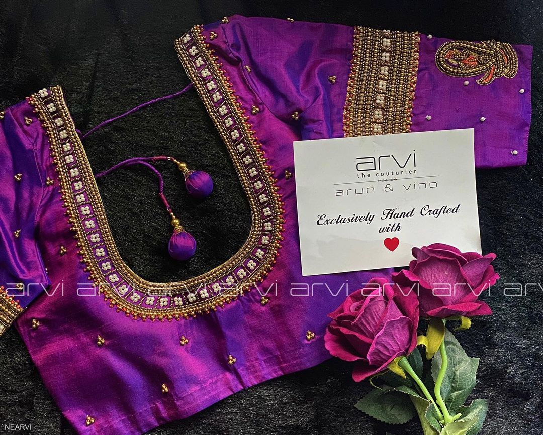 Gorgeous purple color designer blouse with swan design hand embroidery bead aari work.  2021-02-14