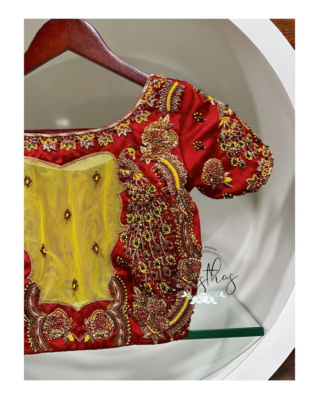 Gorgeous red color bridal blouse with peacock design hand embroidery 3D aari work.  2021-02-17