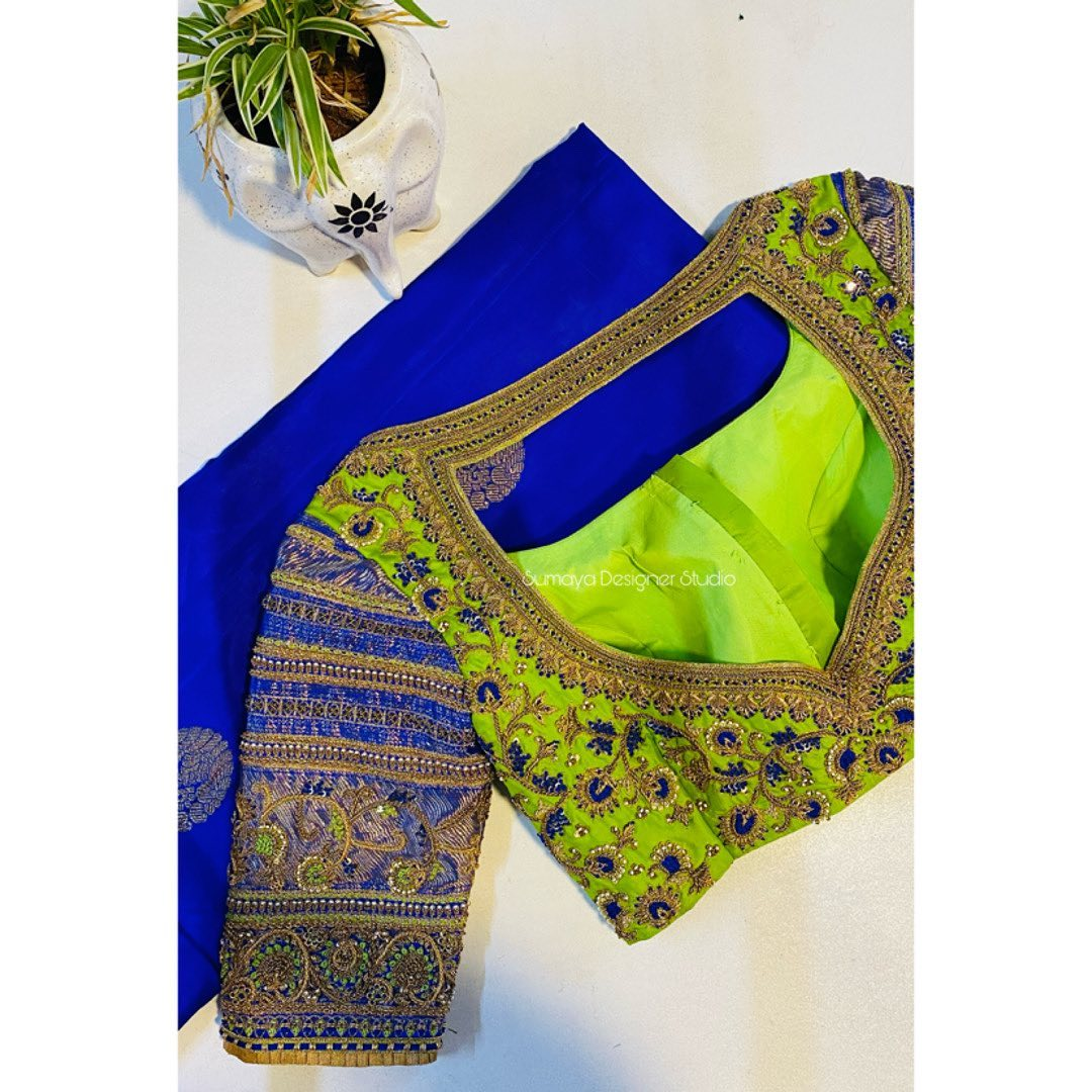 Gorgeous parrot green and blue color combination designer blouse with bead and thread aari work. 2021-02-18