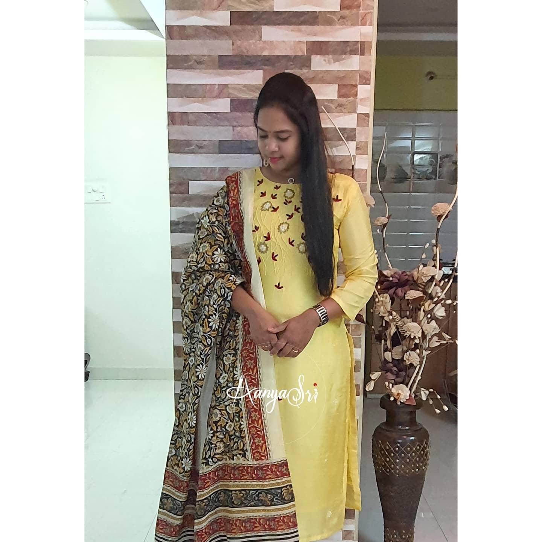 Stunning lime yellow color kurti with kalamkari dupatta. Kurti with floral hand embroidery work on yoke.  2021-02-19