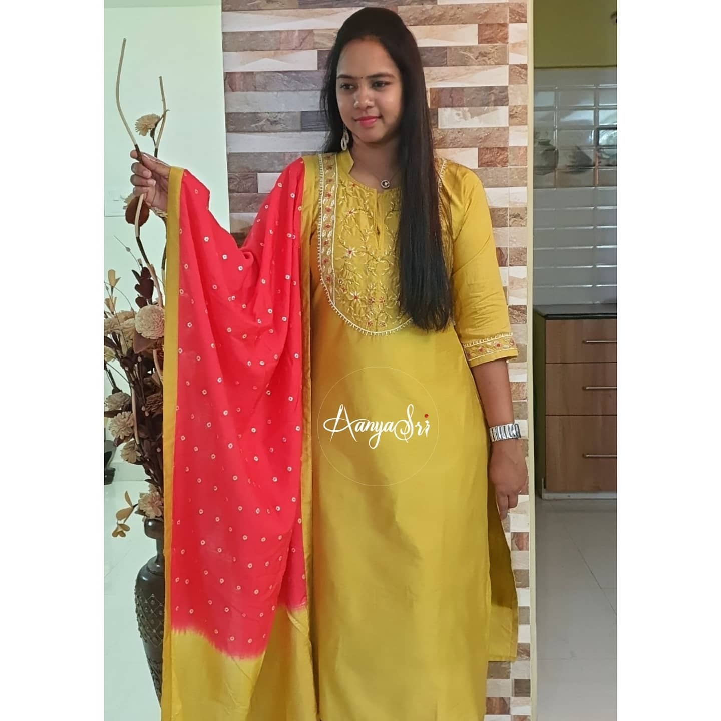 Lovely mustard yellow color kurti with dual shade dupatta. Kurti with hand embroidery work on yoke.   2021-02-19