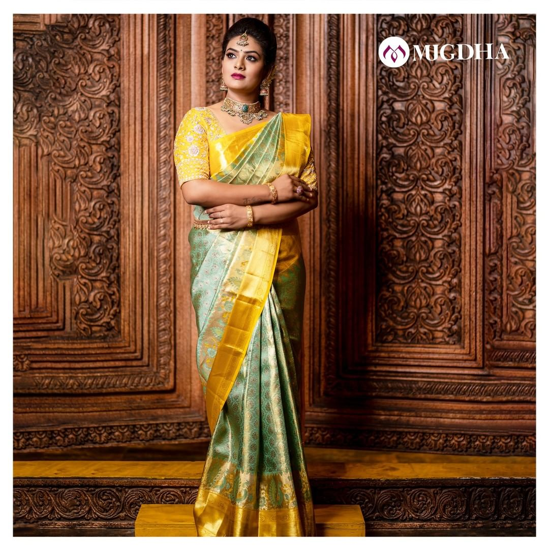 Beautiful vibrant pastel green kanjeevaram saree with yellowish border has rudraksha motifs which looks elegant and also adds the relevance and meaning to the contemporary culture.  For orders - +91 8142029190 and +91 7993710111. 2021-02-19