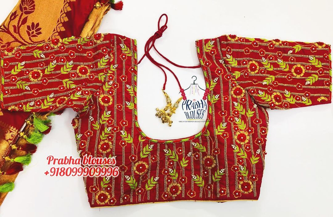 Stunning red color designer blouse with 3D floral and leaf design hand embroidery thread maggam work.  2021-02-19