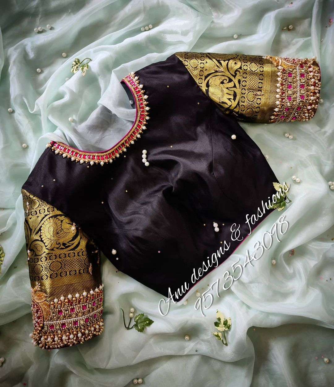 Stunning black color jewel theme blouse with vanki design hand embroidery aari work on sleeves.  2021-02-20