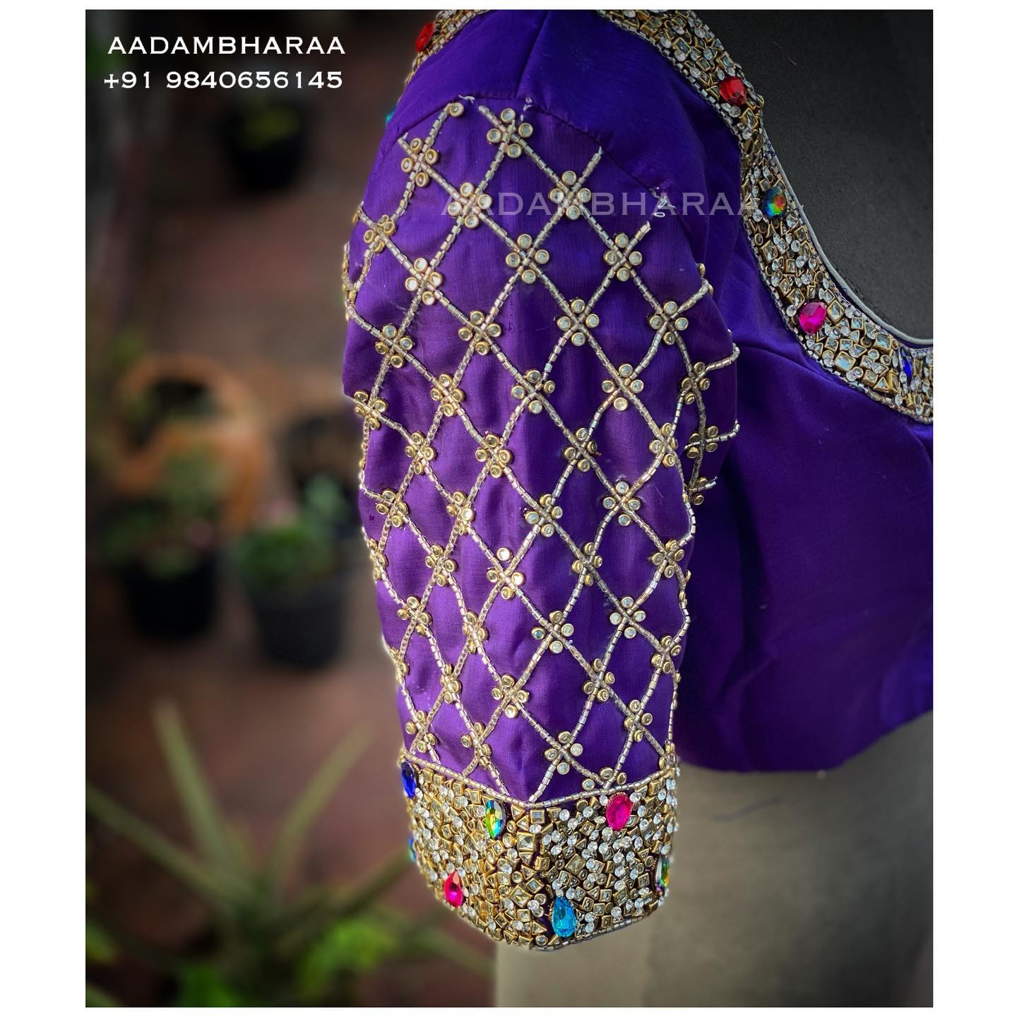 Carefully crafted by Aadambharaa experienced karigars here is a blingy bridal blouse from Aadambharaa that is sure to put you on spotlight! The purple blouse is studded with stones and crystals that are hand embroidered to add sparkle to your ensemble. 2021-02-21