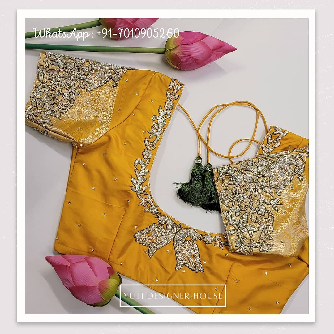 Gorgeous yellow color designer blouse with peacock design hand embroidery silver thread and stone aari work.  2021-02-21