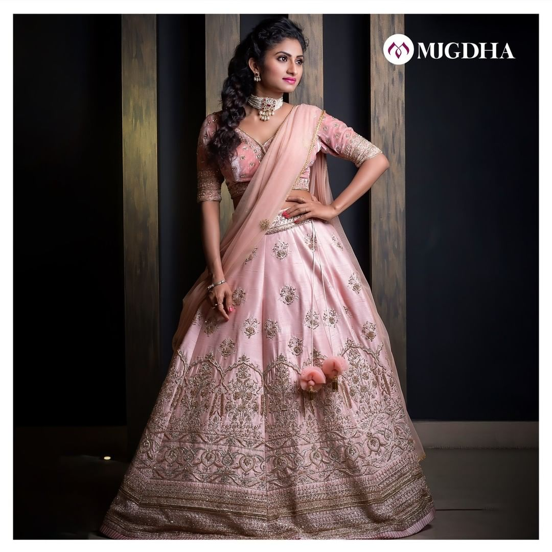 Baby pink raw silk lehenga with Intricate handwork of zardozi and a velveteen hand embroidered blouse. Make your look special with this unique ensemble. 2021-02-21