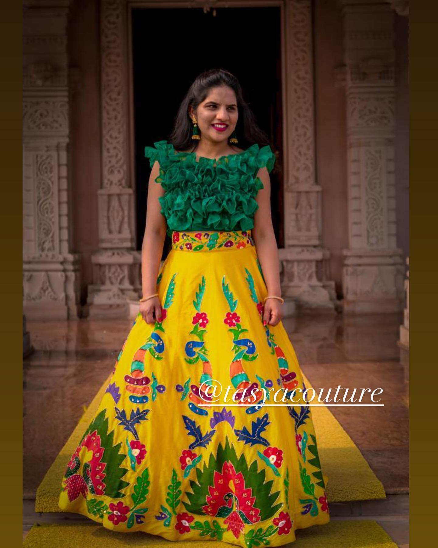 Stunning yellow color skirt and green ruffle crop top. Skirt with hand embroidery work.  2021-02-22