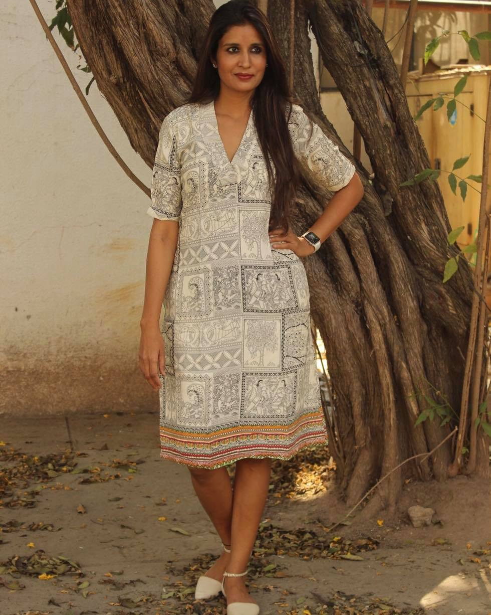 Madhubani Printed V Neck Shift Dress.  Whether you let your hair down or tie up a pony chalk boutique dress will take you every where!  Pair it up with shoes and a cover up and you are all set to let your hair loose
