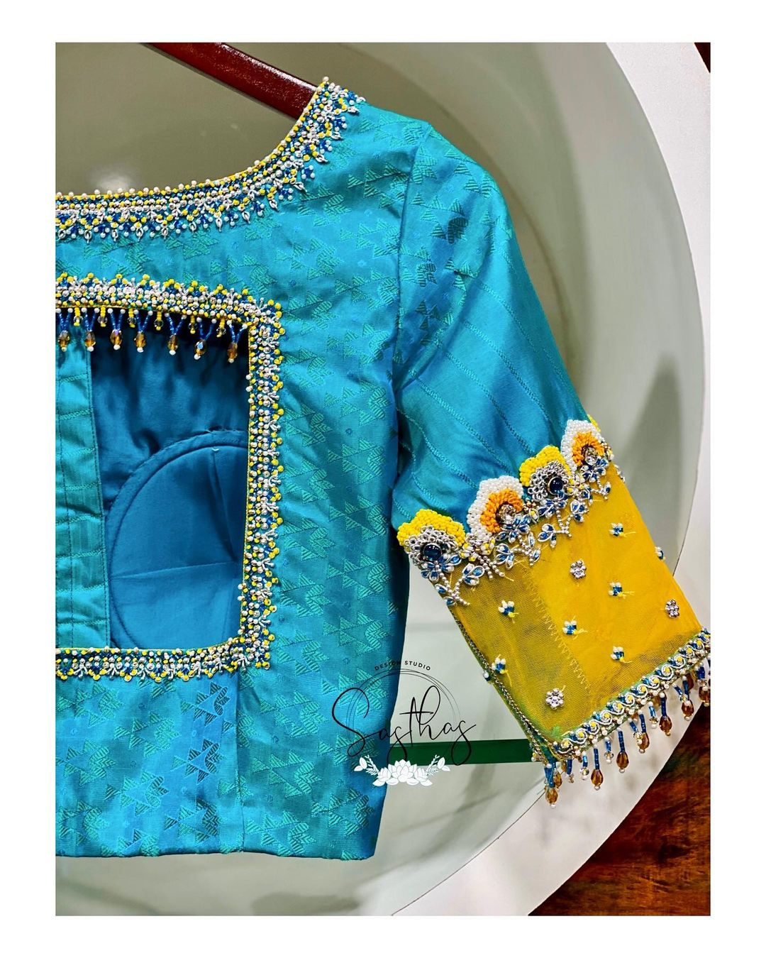 Gorgeous sky blue color designer blouse with silver thread and bead aari work. 2021-02-22