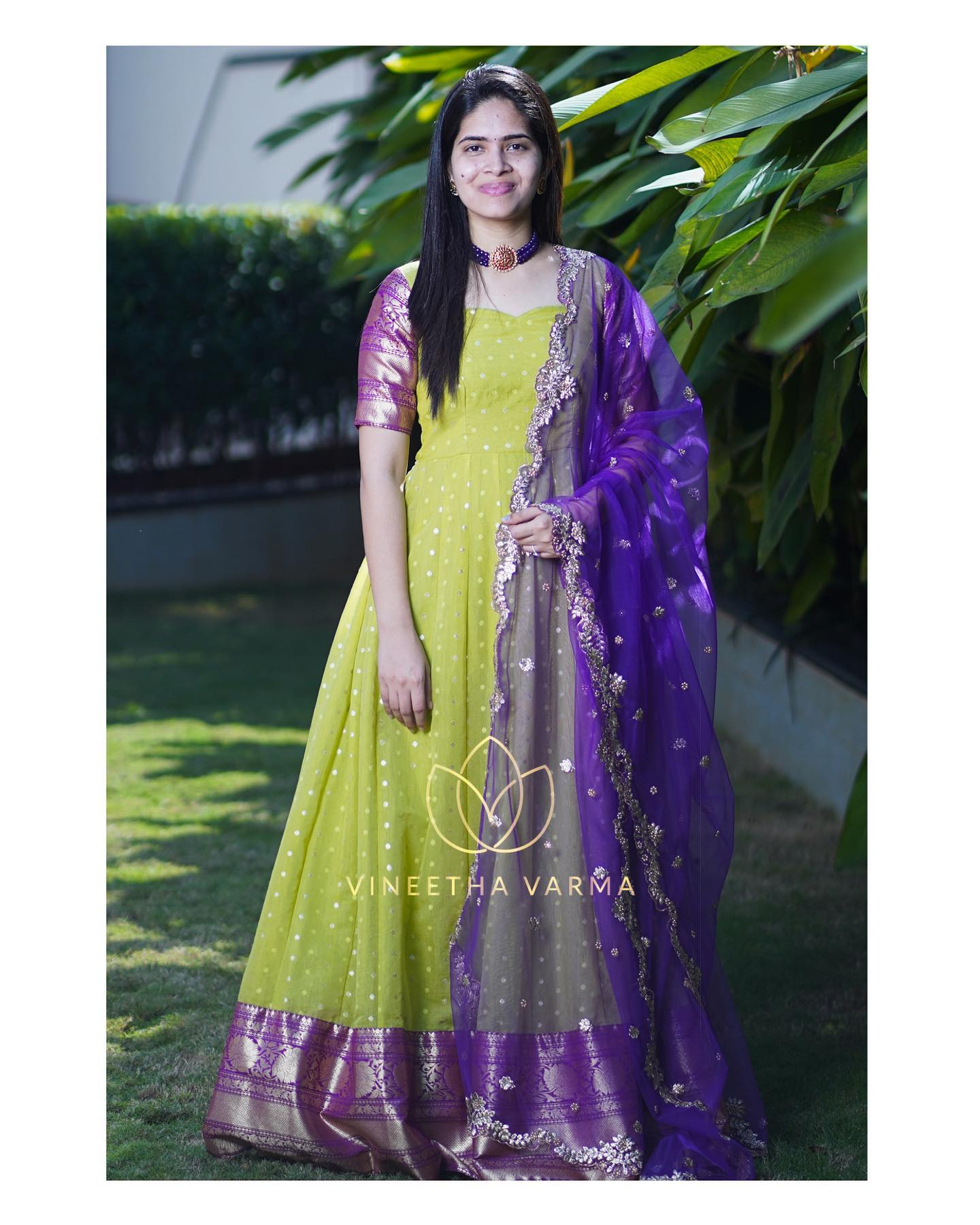 Gorgeous parrot green and purple color combination traditional pattu long frock with cut work net dupatta. 2021-02-24