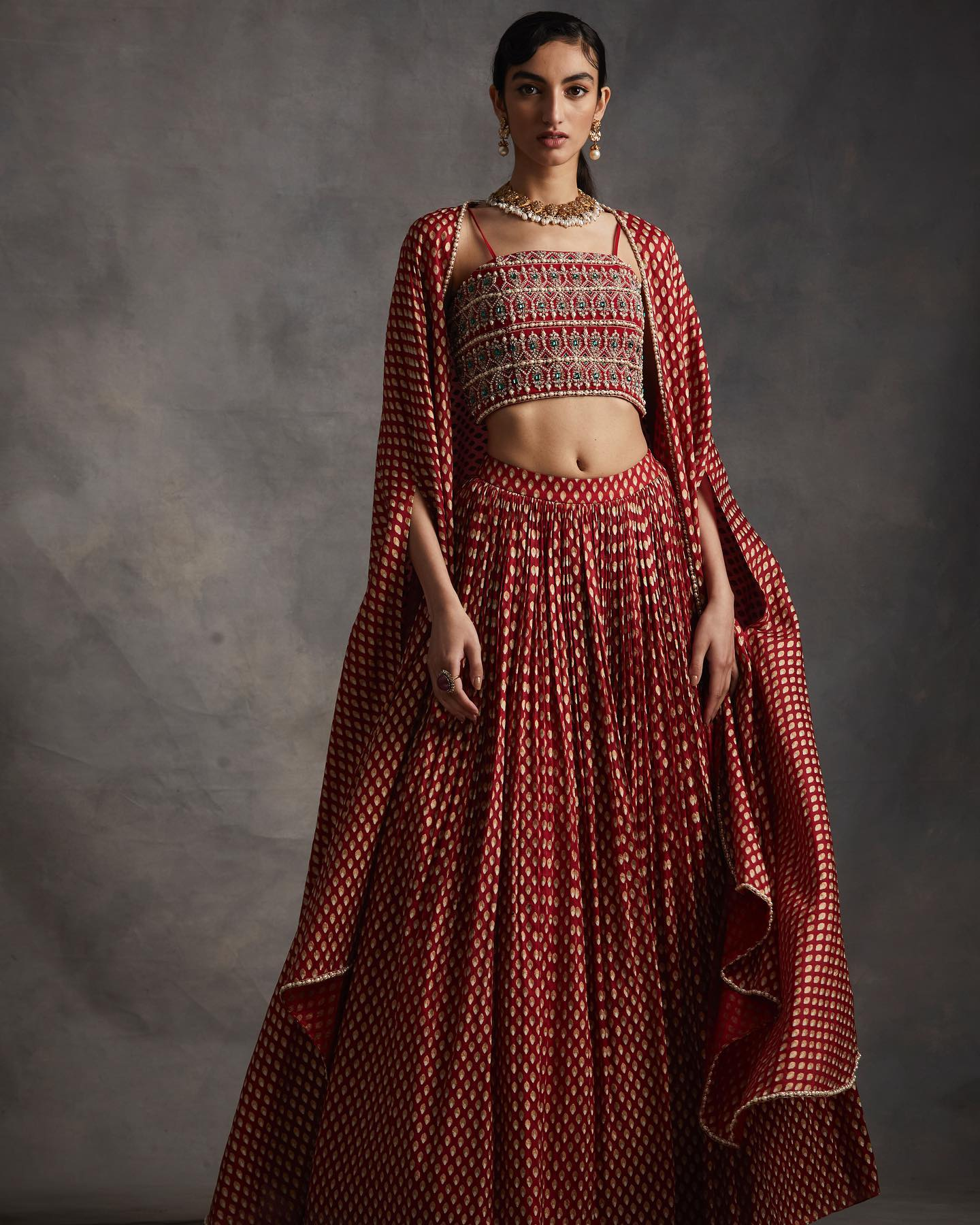 SUMMER ROMANCE . FESTIVE 2021 . PART 2  LOOK 7 - Ruby Red Bindu Print Long Cape Skirt and Embroidered Bustier. 2021-02-24