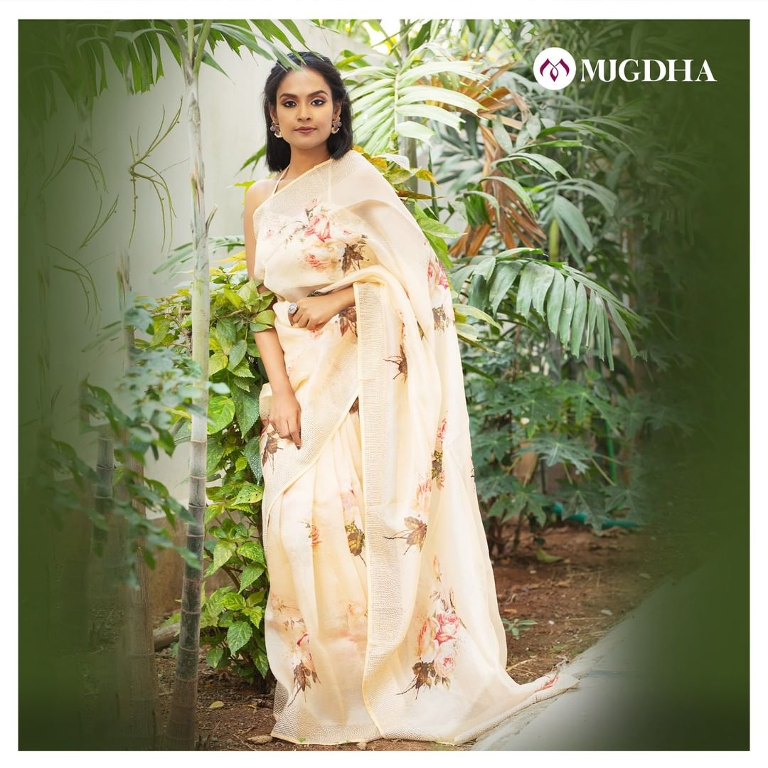 Beautiful and Classy Cream color floral print organza saree with embellished silver stone border It looks great for an evening high tea or any informal visitings. 2021-02-24