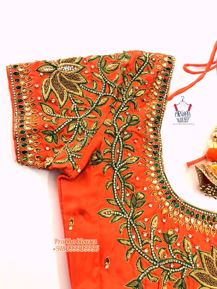 Stunning orange color designer blouse with lotus and creeper design hand embroidery thread and stone maggam work.  2021-02-26