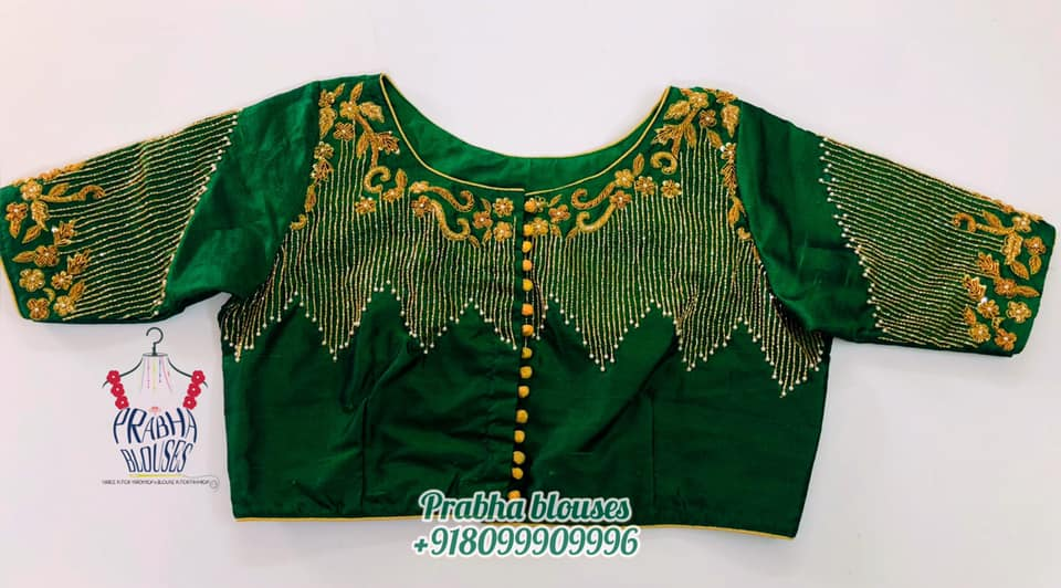 Gorgeous bottle green color designer blouse with floral and creeper design hand embroidery zardosi work.  2021-02-26