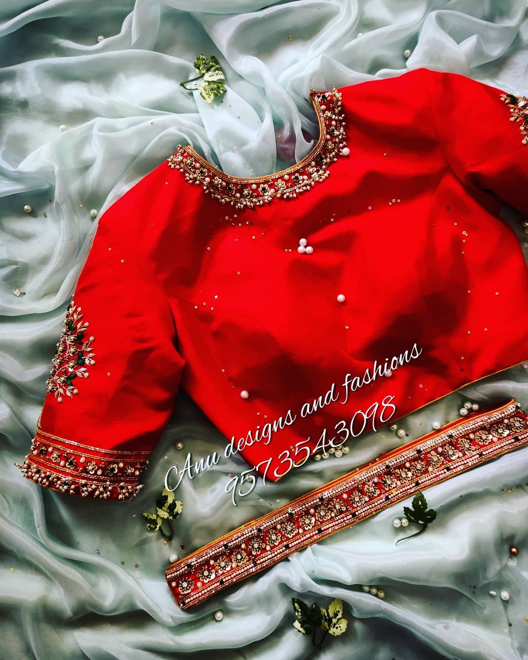 Stunning red color designer high neck blouse with jewel theme guttapusalu hand embroidery work and wasit belt.  2021-02-26