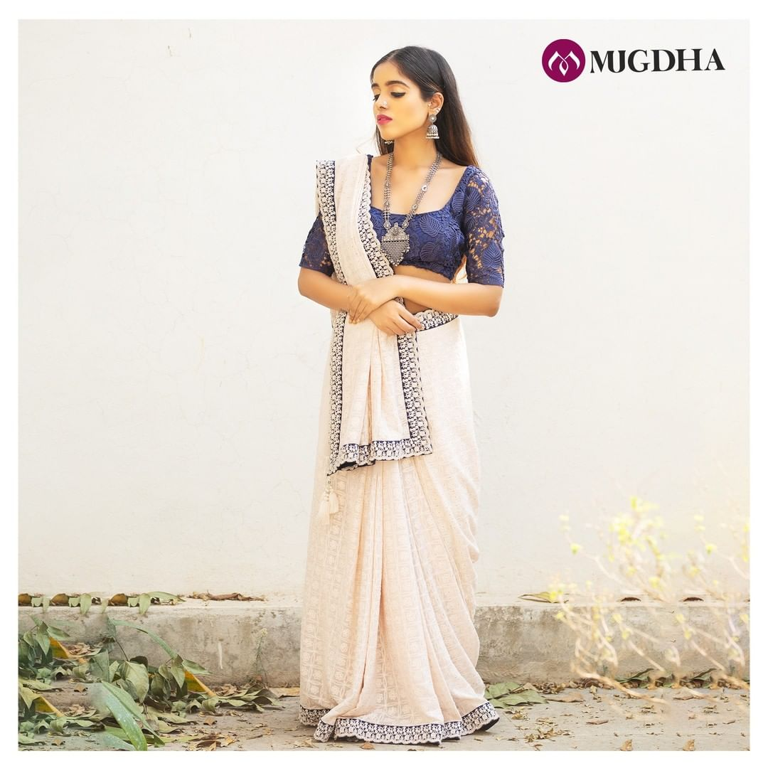 Voguish White color fancy saree with chikankari embroidery work and tiny cut work border teamed up with a violet net blouse  This saree completely transforms the whole look and adds grace to your contemporary party style. For orders and enquires: +91 7993710111. 2021-02-26