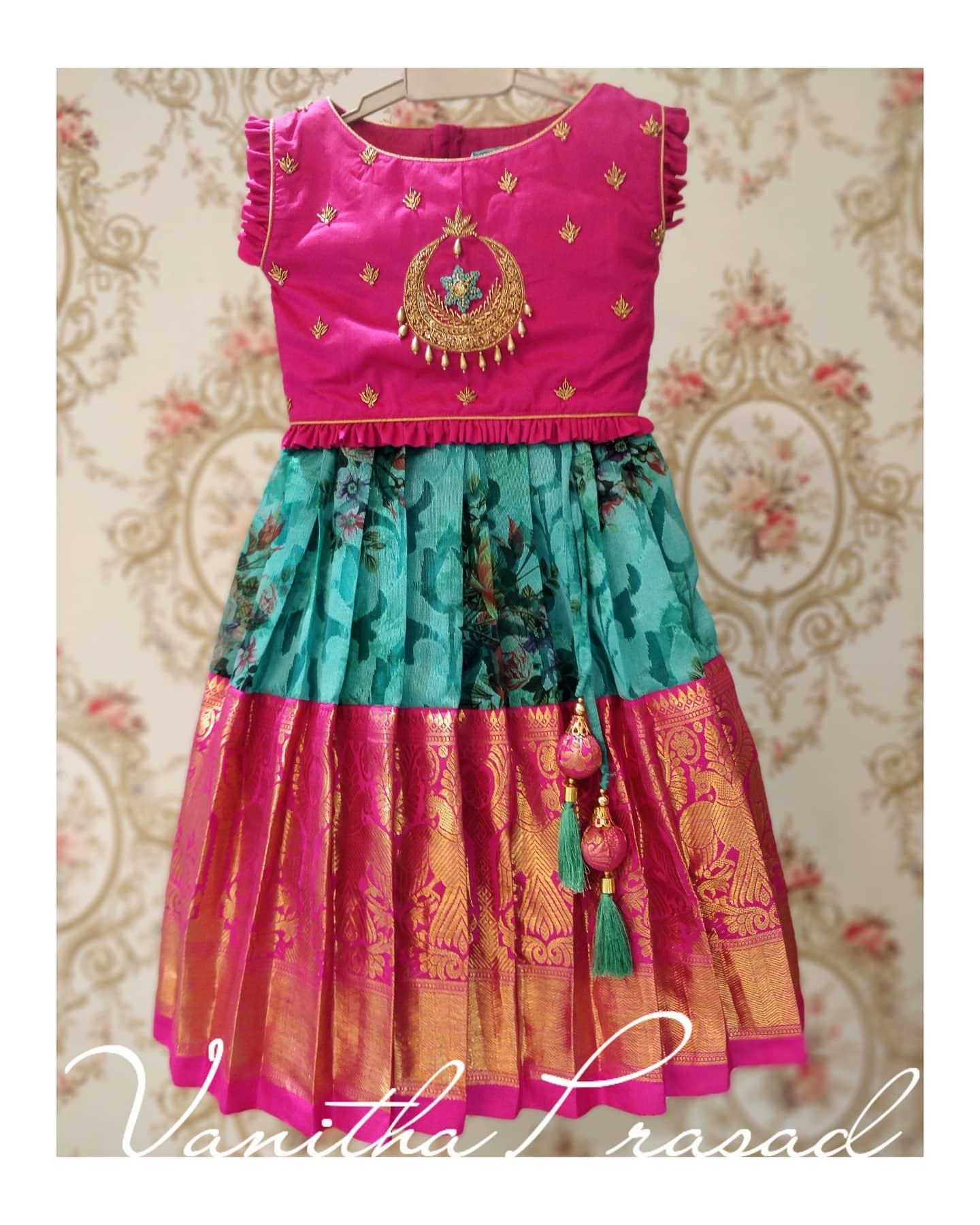 Gorgeous kids floral pattu lehenga and pink color peplum top. Top with chaandbali hand embroidery work on yoke.  2021-02-28