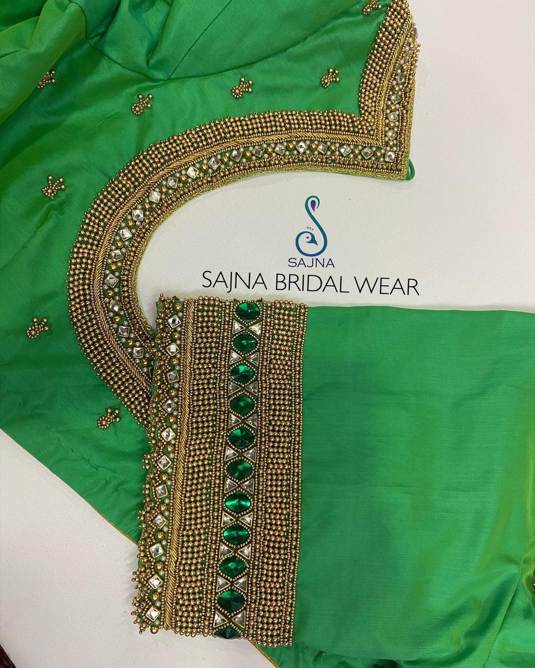 Gorgeous green color designer blouse with bead and glass bead hand embroidery aari work on neckline and sleeves.  2021-03-01