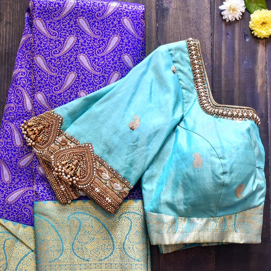 Classic vanki! Stunning sky blue color designer blouse with Lakshmi vanki design hand embroidery aari work.  2021-03-02