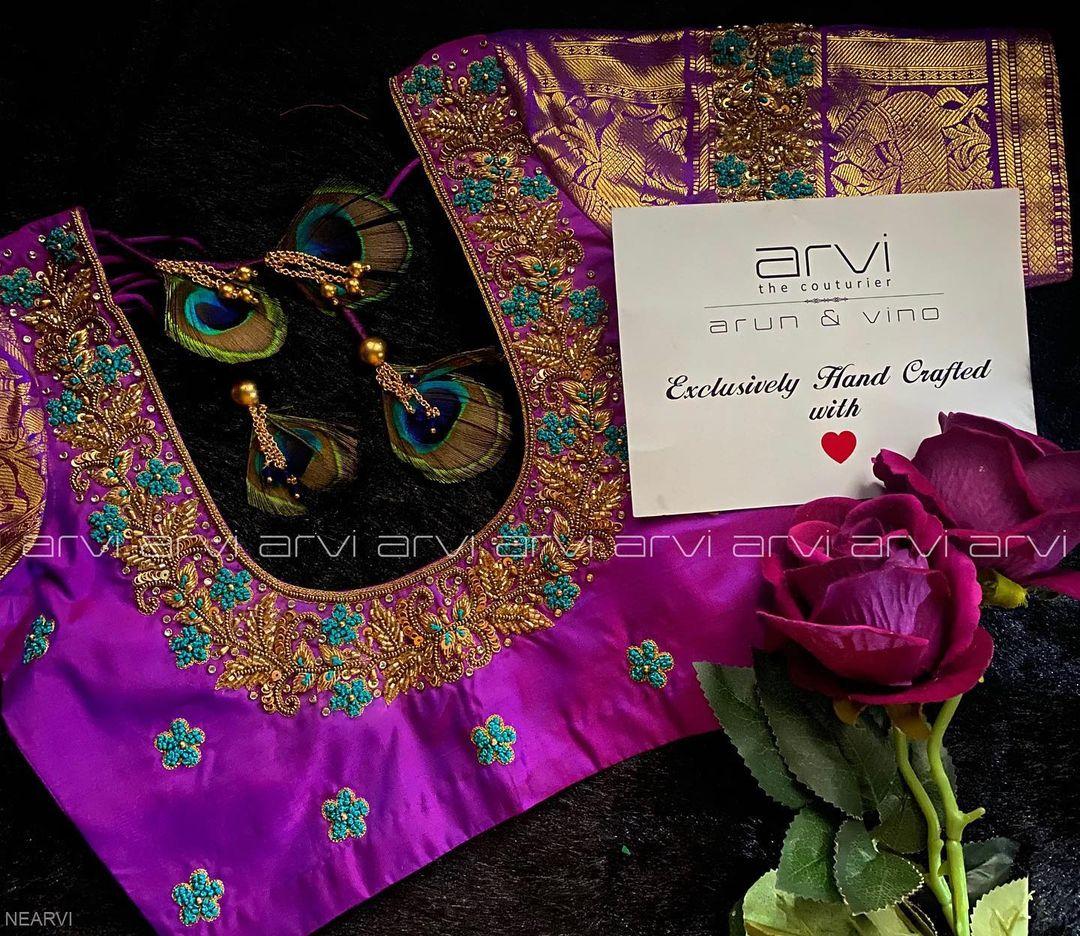 Stunning purple color kanchi pattu designer blouse with floral aari work. 2021-03-02