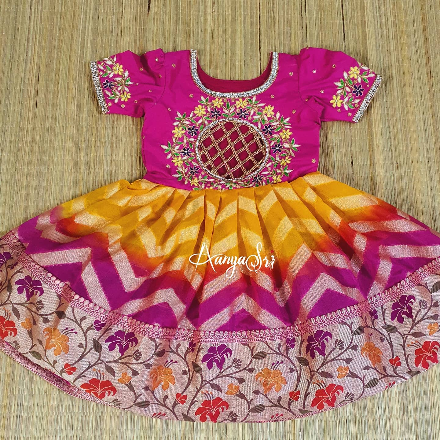 How cute is this! Beautiful pink and yellow color combination paithani pattu kids gown with floral and creeper design hand embroidery work on neckline.  2021-03-04
