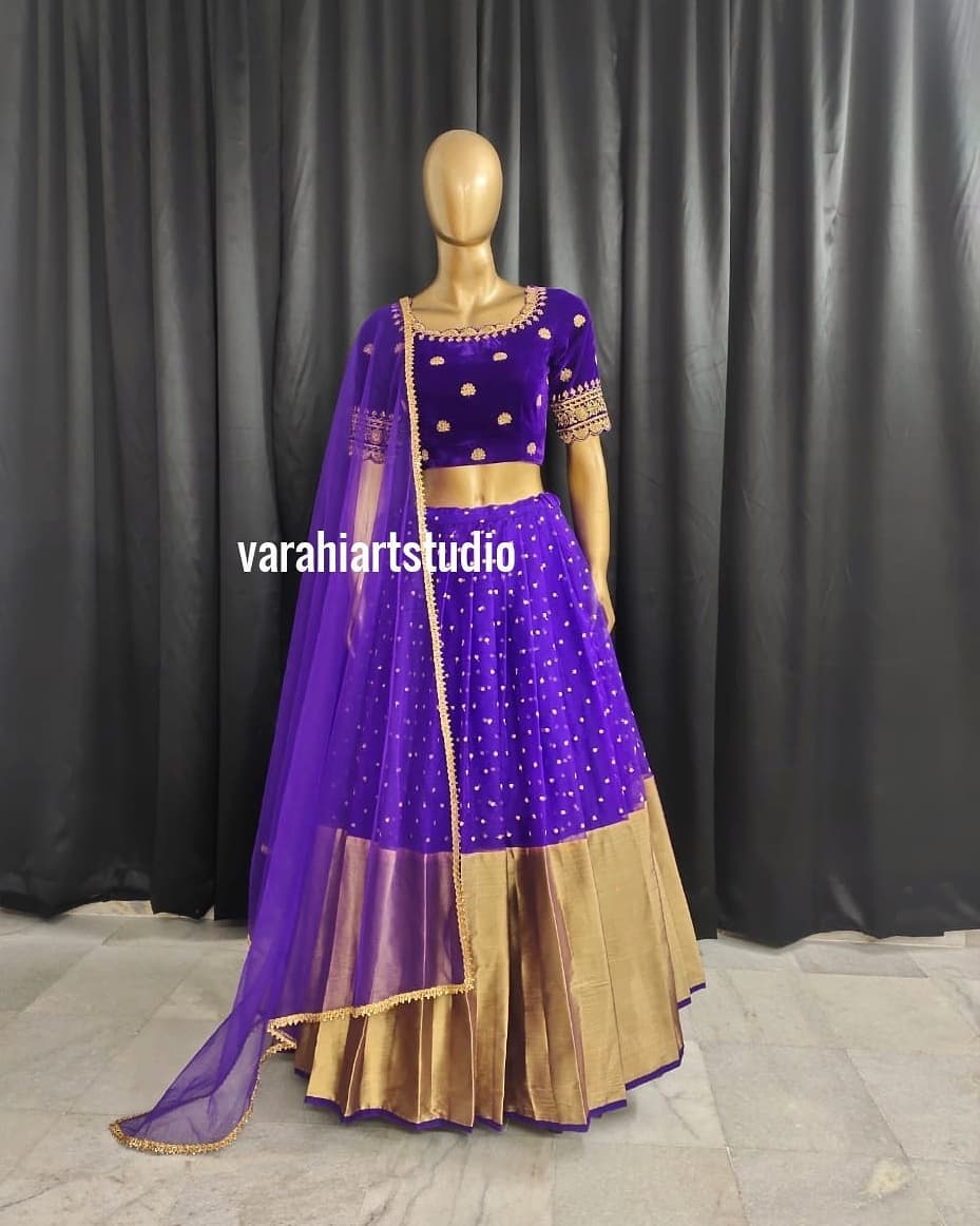 Stunning purple color velvet pattu lehenga and blouse with net dupatta. Blouse with hand embroidery work.  2021-03-04