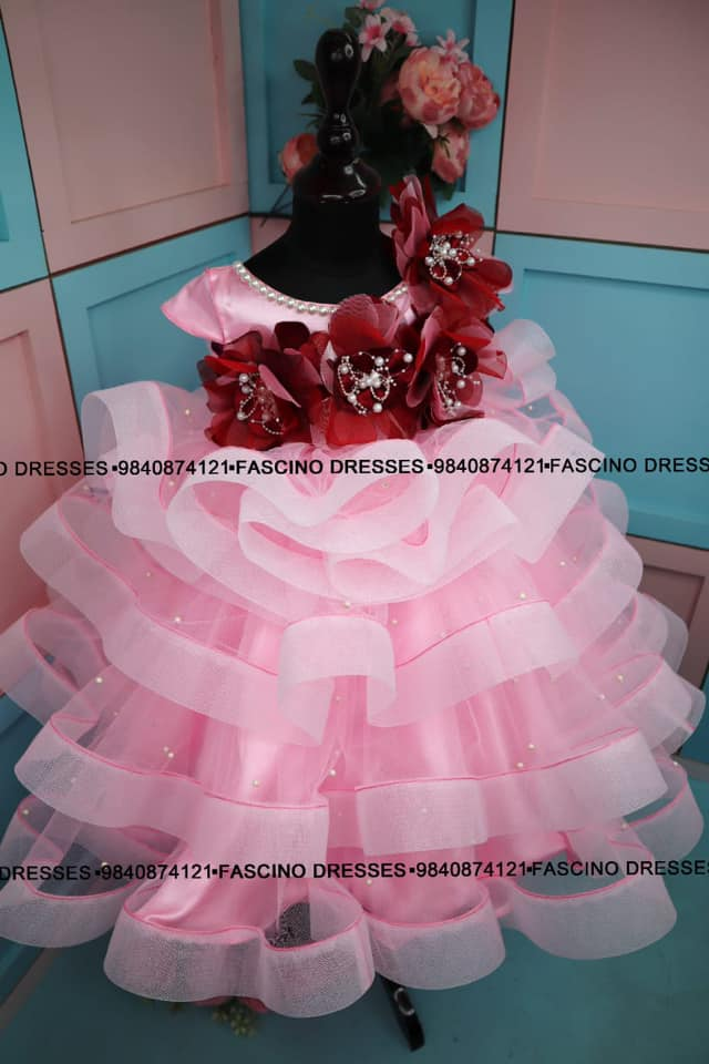 A gorgeous pink Ruffle kids gown from #fascino. 