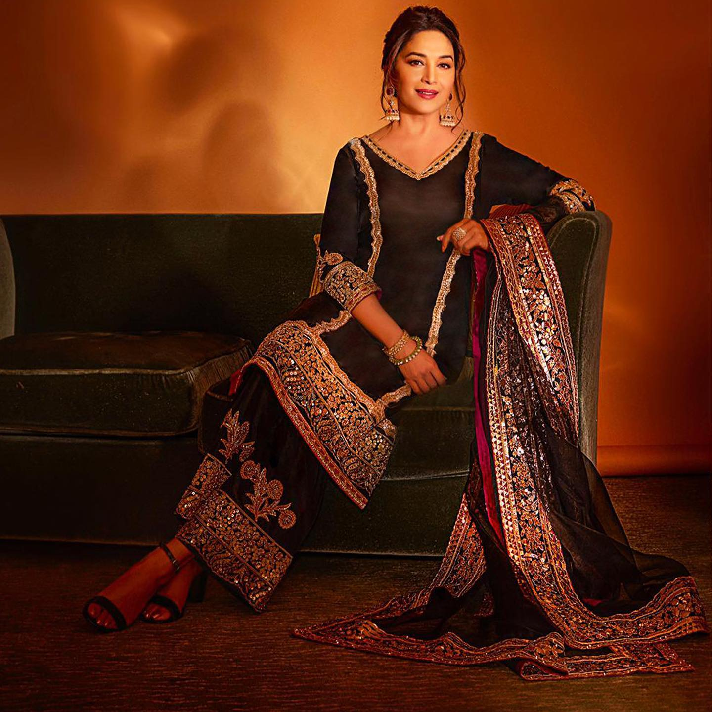 An epitome of timelessness and grace Madhuri Dixit  exudes an innate regal aura in Manish Malhotra ebony kurta intricately emblazoned in antique-gold zari embroidery. 2021-03-05