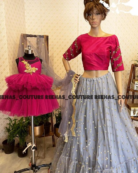 Beautiful mom and daughter out fit. Stunning gray color lehenga and pink blouse with net dupatta. Pink color kids ruffle gown. 2021-03-05