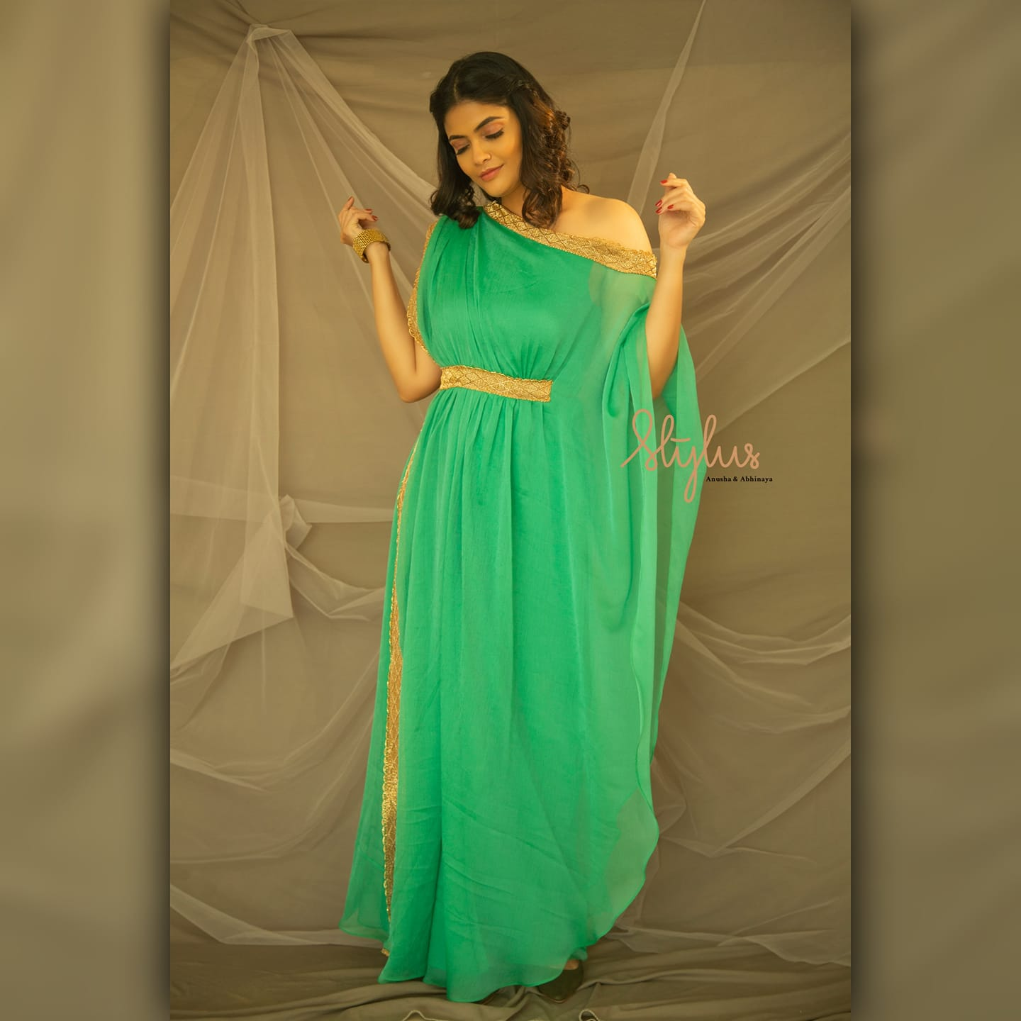 Style while you bedazzle with a smile! Green off shoulder drape frock. Twin with nature the Stylus way. 2021-03-05