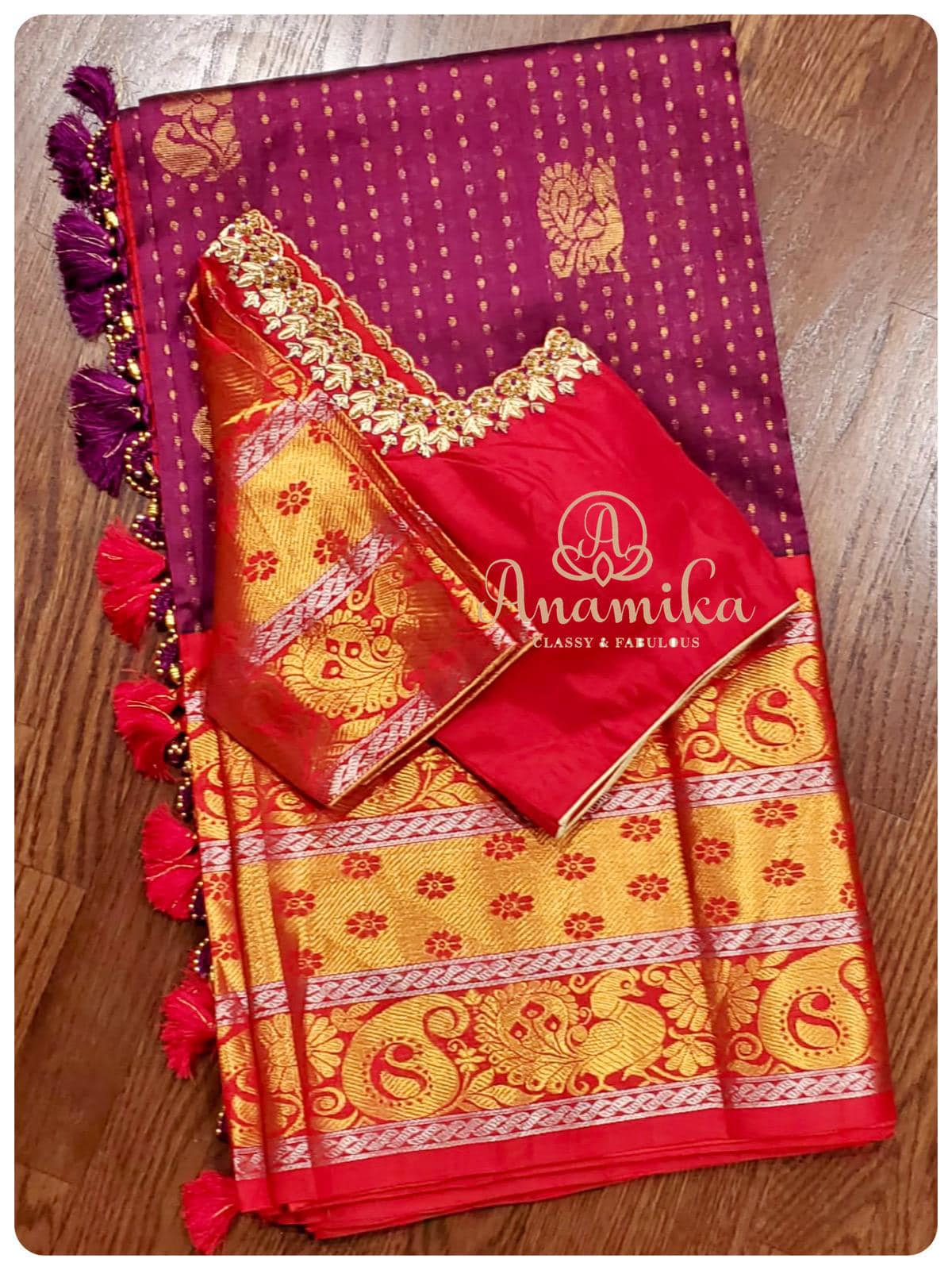 Kuppadam silk saree in a lovely shade of purple with a red kanchi border - so classy and elegant . Paired with a blouse so beautifully and  intricately designed to match the design on the border - simply stunning!! DM 425-598-6797 or 360-545-3636 for enquiries. 2021-03-06