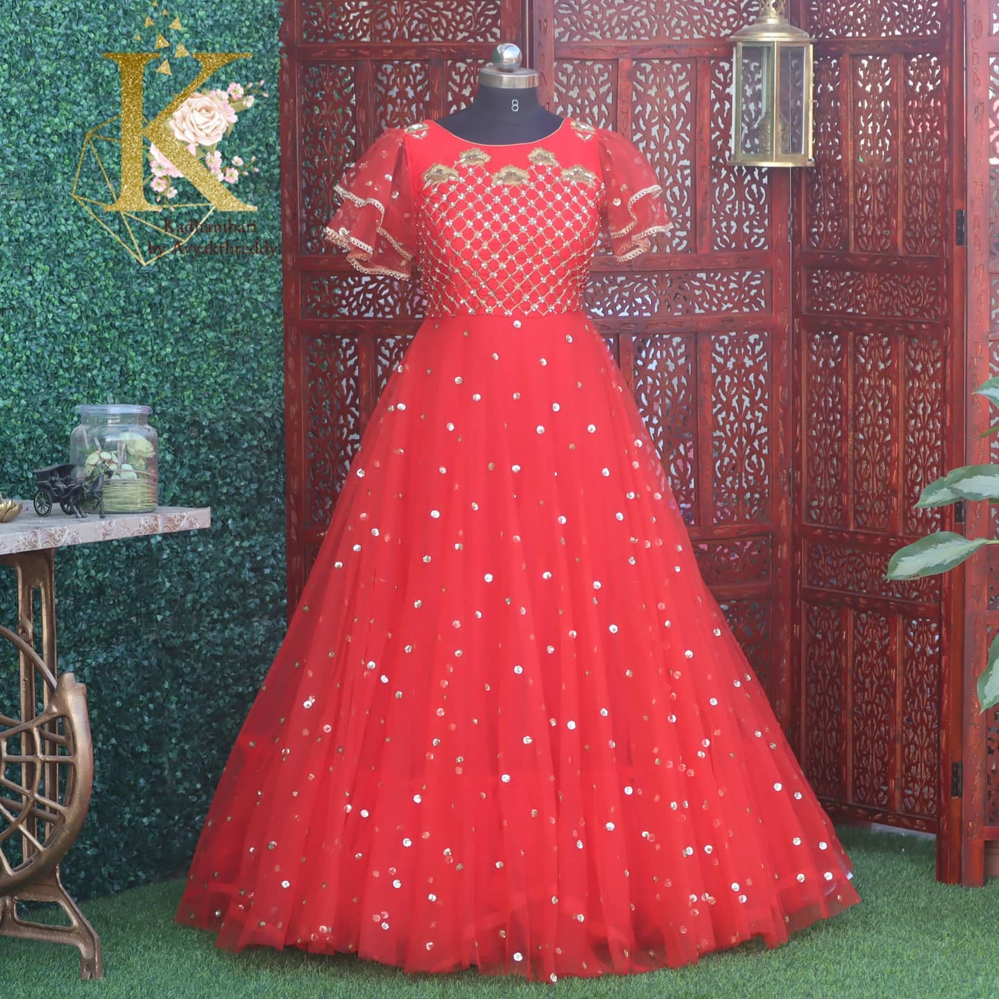 Beautiful red color floor length gown with ruffle sleeves and hand embroidery zardosi work on yoke. This  outfit is Available@11800/- from house of Kadhambari. They can customize size as per your requirement.  They have international shipping service too.  For Orders & Enquiry Reach  on  WhatsApp +91 8801876477  +91 9063479099 . 2021-03-06